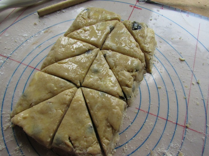 making triangles from blueberry scone dough