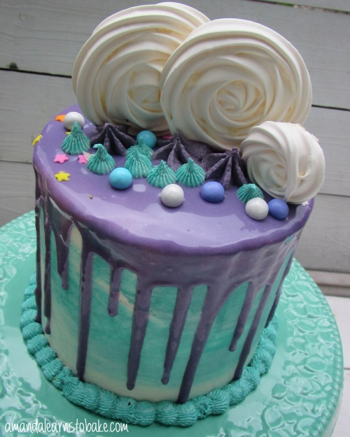 purple teal drip cake meringue swirl view